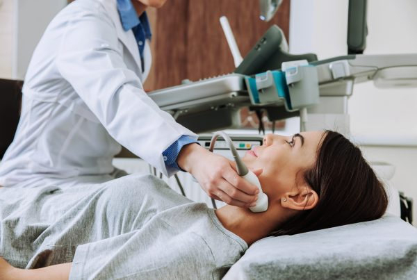 Woman undergoing ultrasound scan in Endocrinology clinic